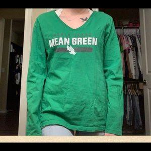 Green, mean green (unt) shirt.